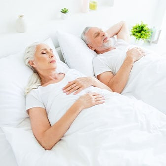 couple sleeping on a bed