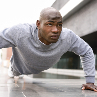 Man in long sleeve gray shirt doing push-ups
