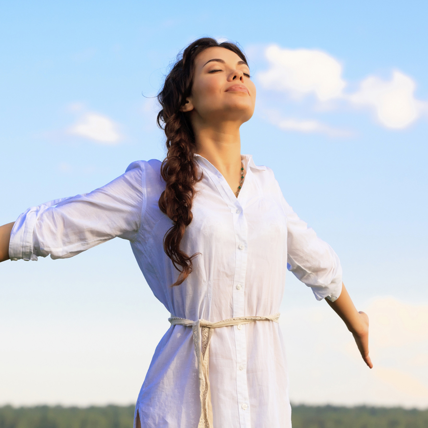 Feel Relaxed – Woman with eyes closed and arms stretched out to sides