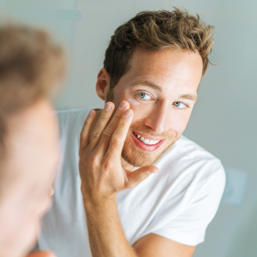 Soothes Redness & Irritation – Man applying cream under eye