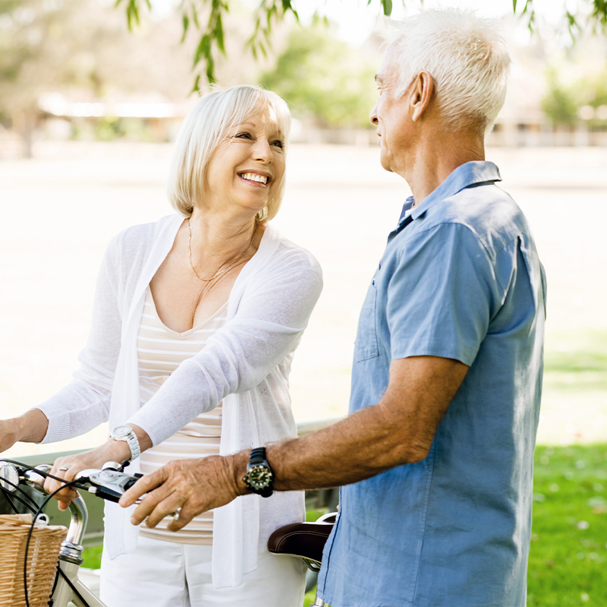 Enjoy More Energy – Middle-aged couple riding bicycles outdoors