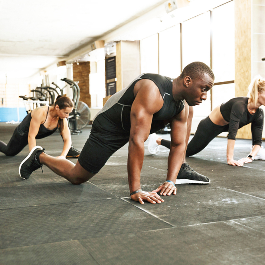 Support Your Body's Building Blocks – Group stretching in preparation for a workout at the gym
