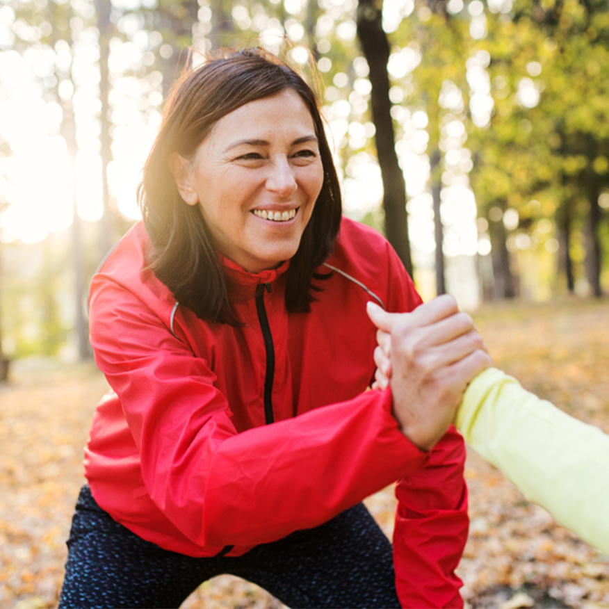 Protects DNA Integrity – Woman doing partner exercises at a park
