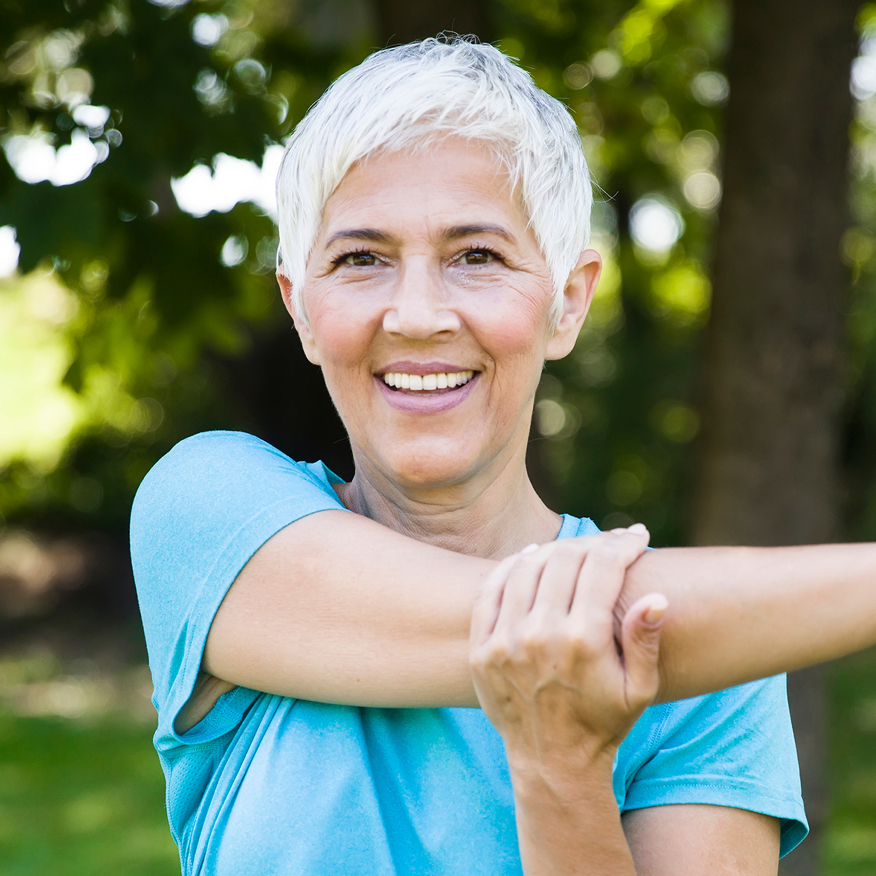 Complete, Potent Formula – Middle-aged woman stretching arm across her chest
