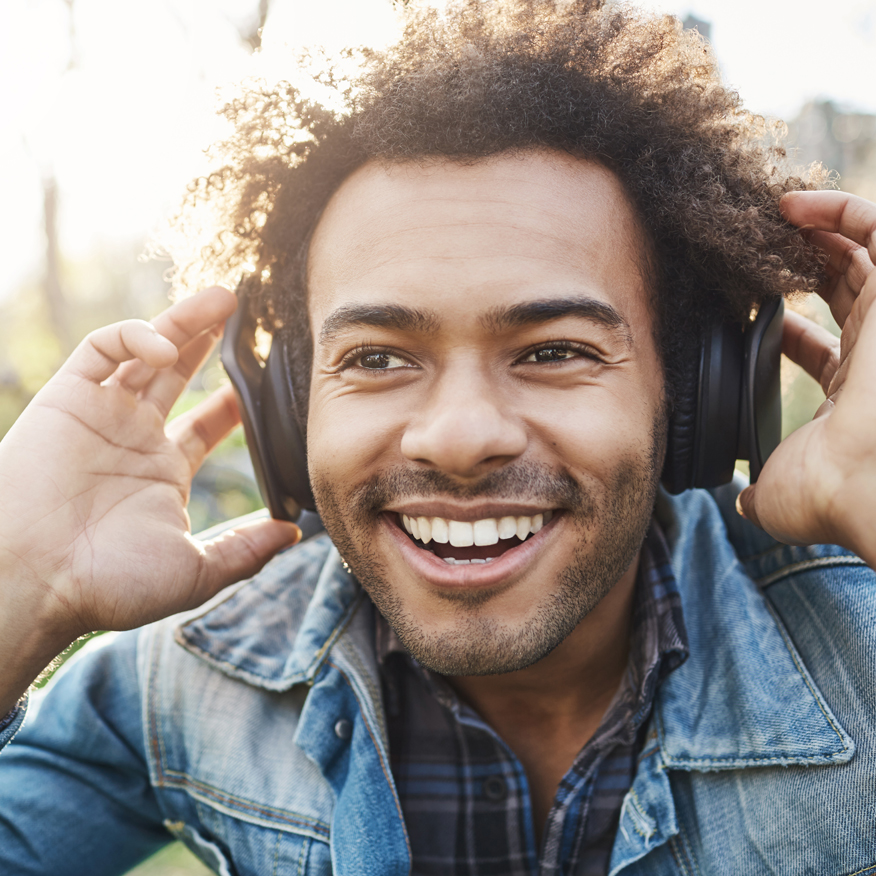 Supports Cardiovascular Health – Man listening to music outdoors