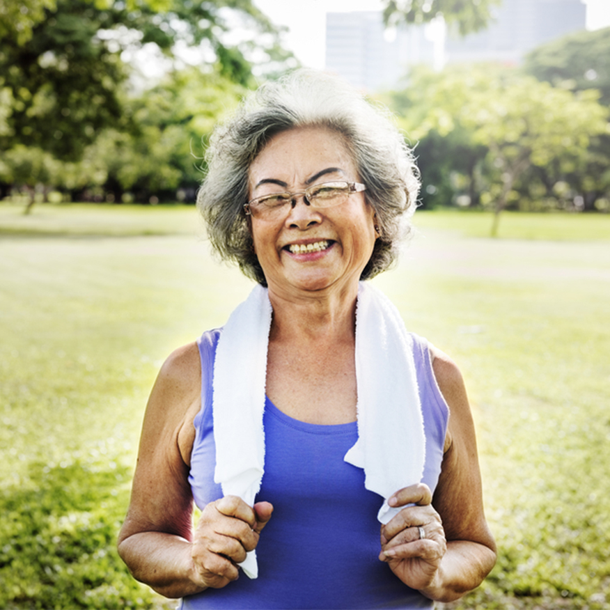Reduce Diet-Related Inflammation - Mature woman in park with towel around neck