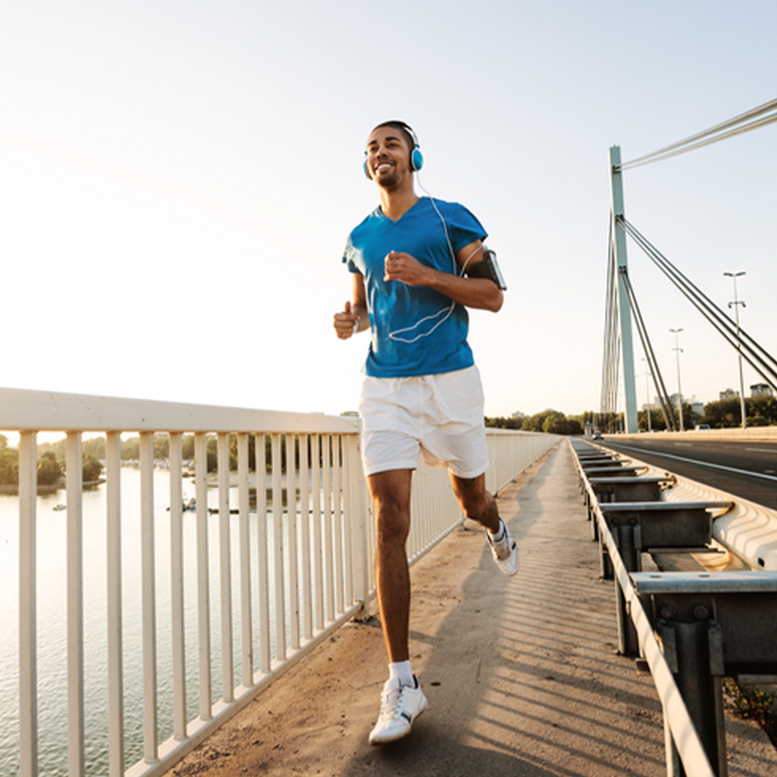 Stay Energized – Man running along bridge