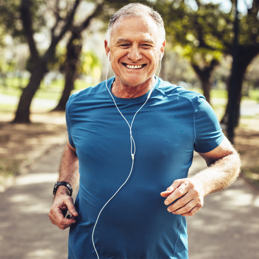 Heightens Energy Levels – Middle-aged man jogging on a park trail