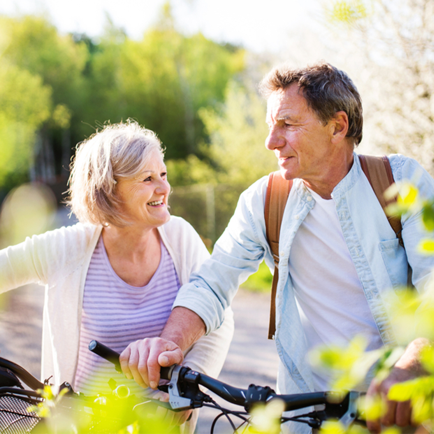 Cardiovascular Health – Elderly couple biking outside