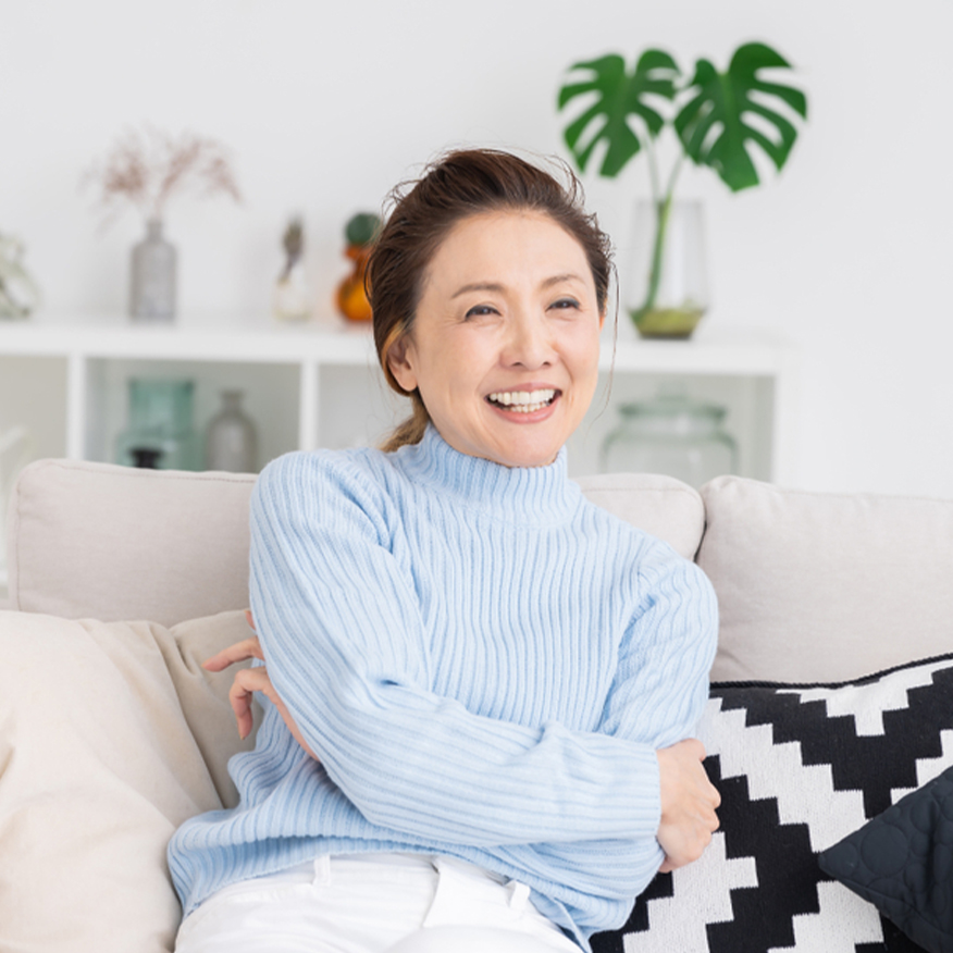 Boosts Happiness – Woman resting on couch and smiling