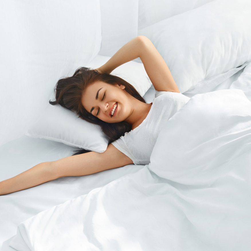 Promotes Restful Sleep – Woman happily sleeping