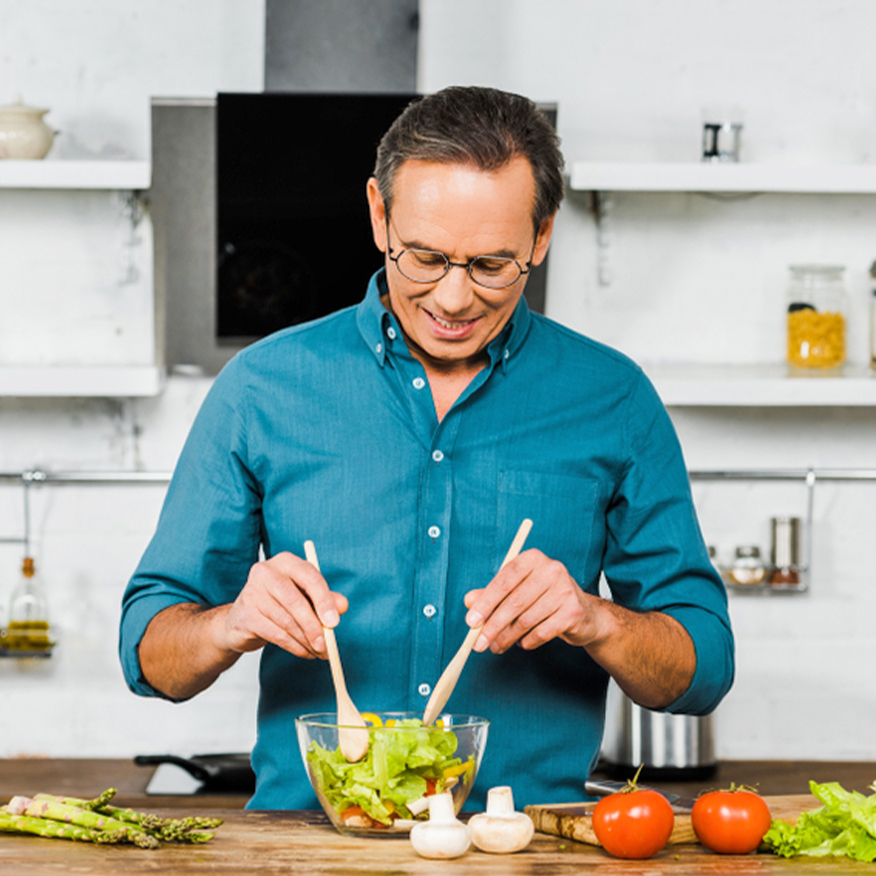 Protects the Liver – Man tossing a salad in the kitchen