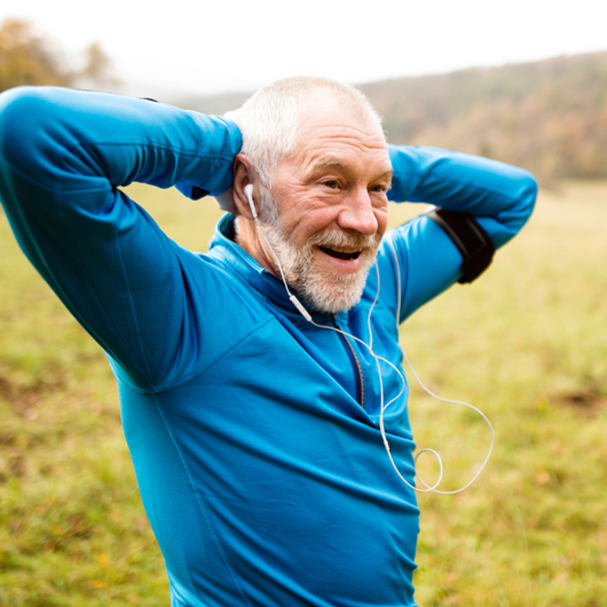 Support Your Immune System – Middle-aged standing outdoors stretching with his arms behind his head