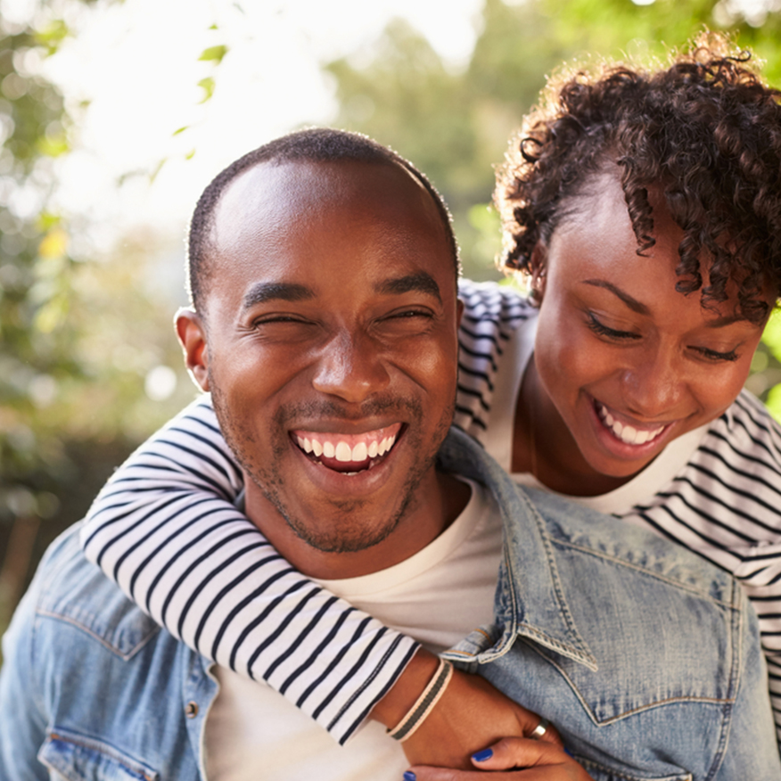 Helps With Skin Concerns – Man and woman laughing outdoors