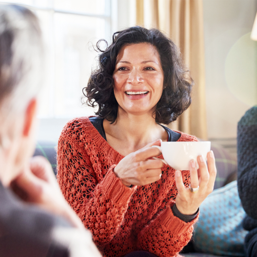 Supports a Healthy Gut – Woman enjoying a cup of tea with friends
