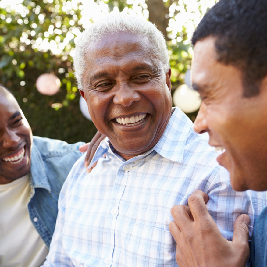 Gets Rid of Digestive Ailments – Trio of men chatting and laughing at an outdoor party