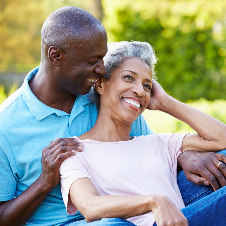 Soothes Irritated Tissue – Couple sitting close together outdoors and laughing