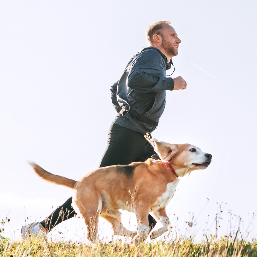 Supports Normal Urinary Function – Man jogging with dog alongside