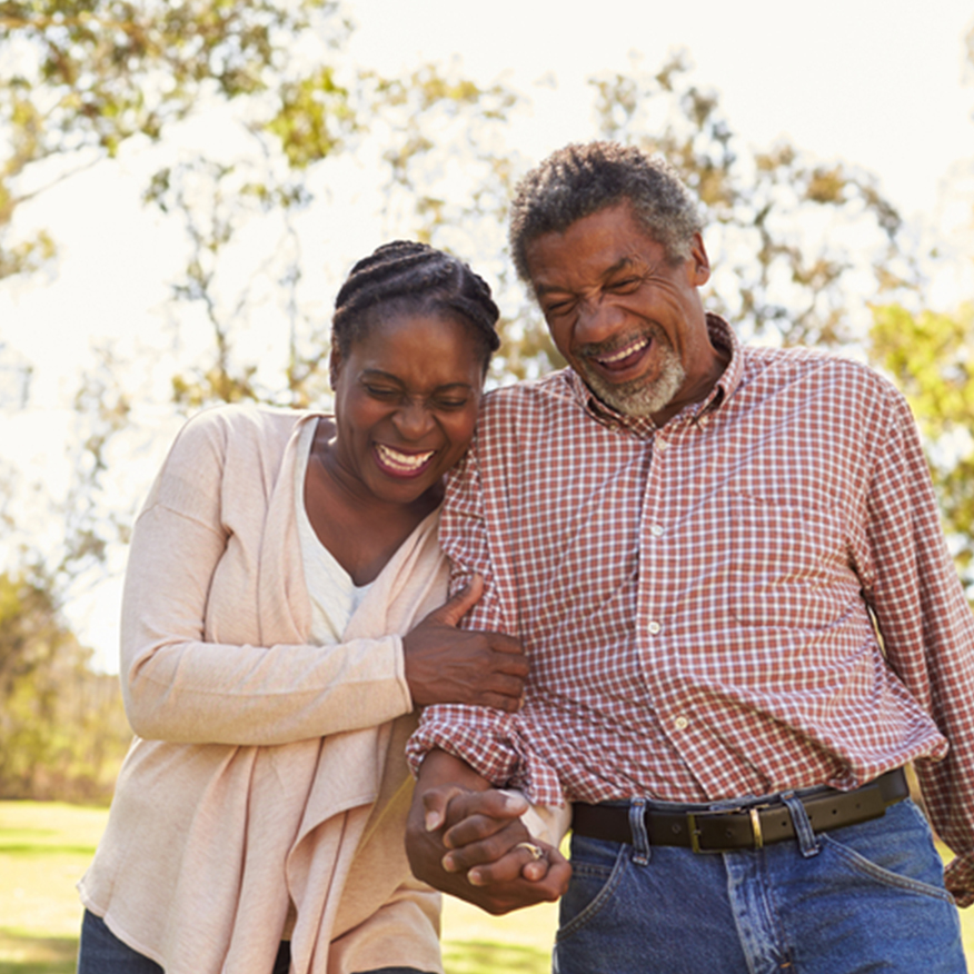 Anti-Aging Antioxidant – Couple holding hands walking and laughing