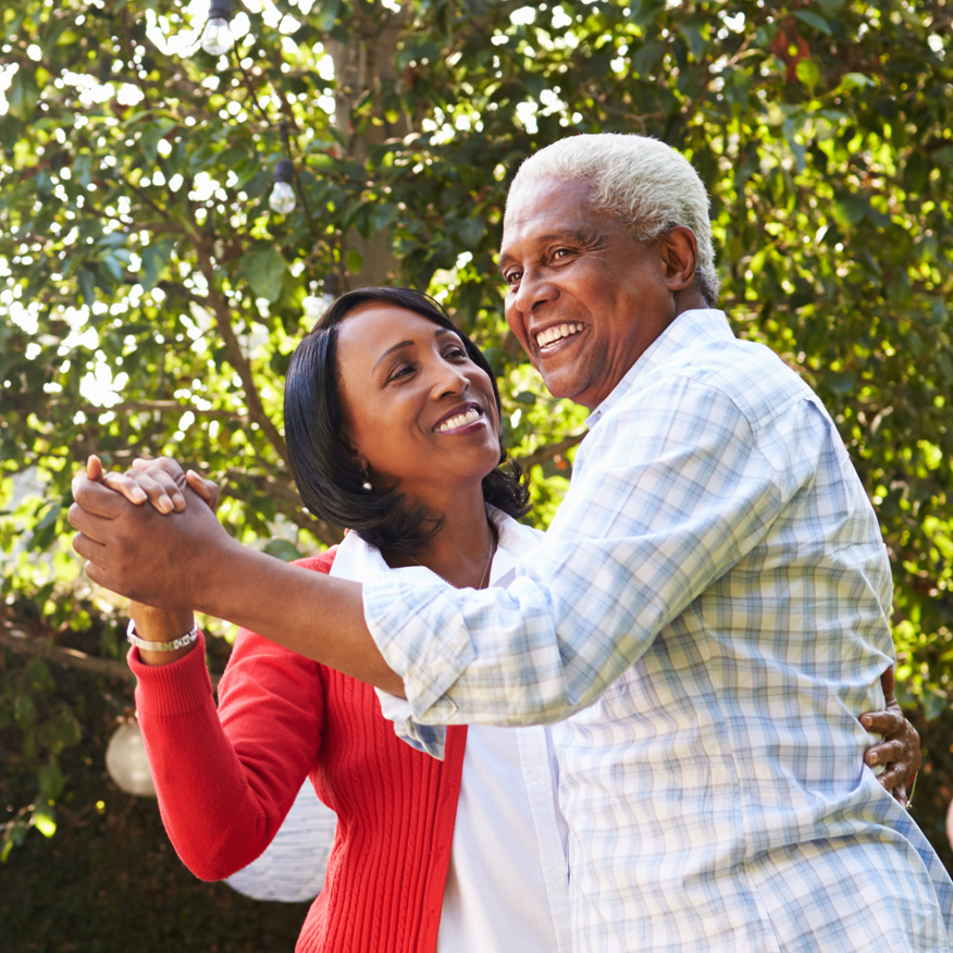 Enhances Learning & Memory - Elderly couple dancing together outdoor under a tree