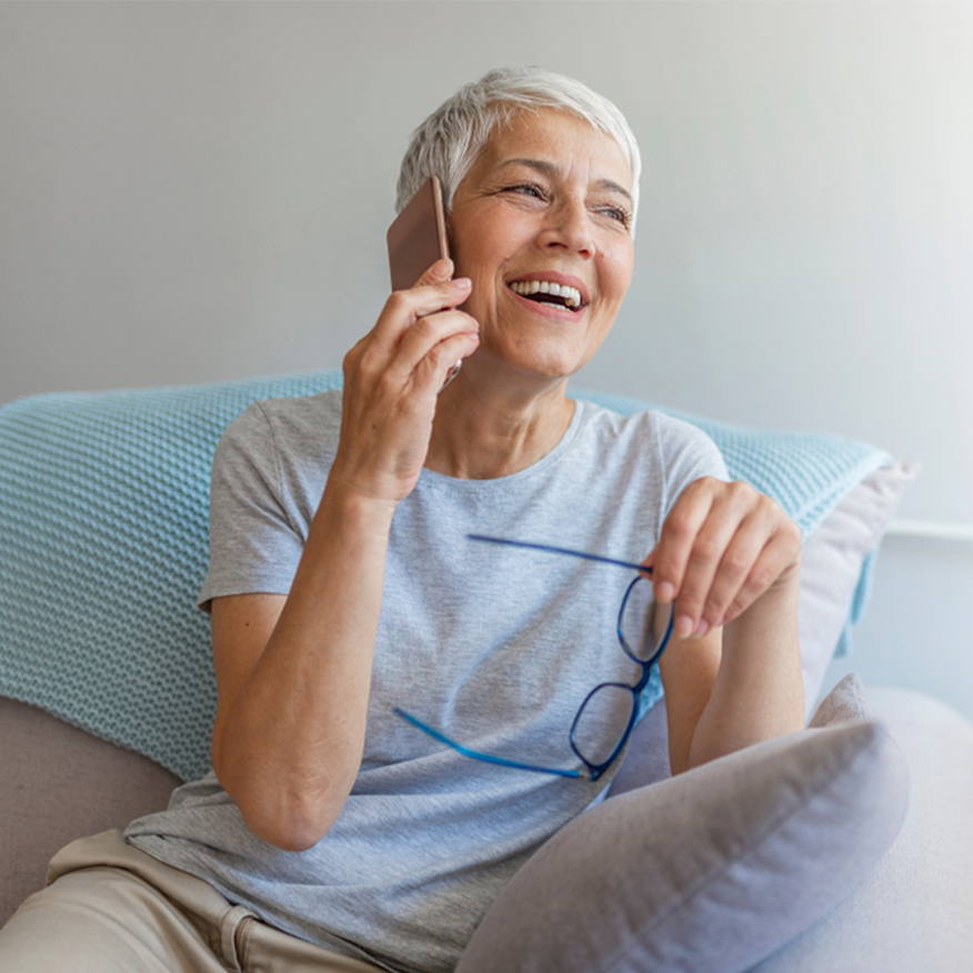 Supplements Age-Related Decline – Older woman sitting on couch on the phone