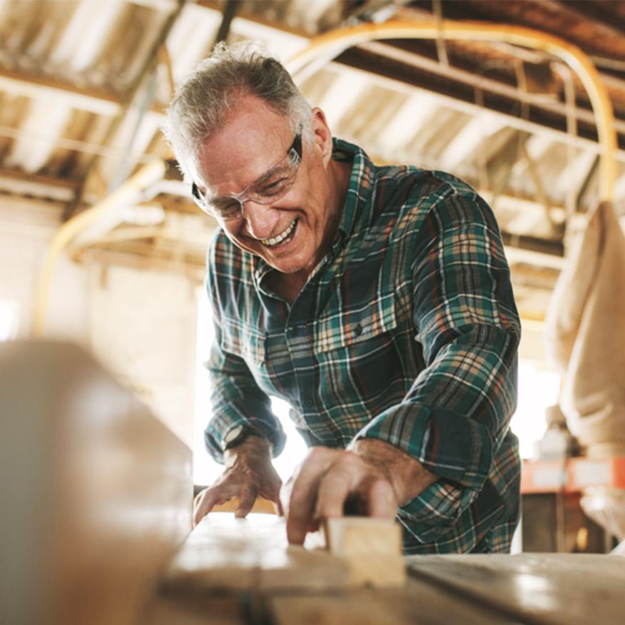 Supports Cognitive Function – Older man doing woodwork at a workshop
